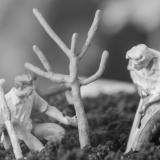 Miniature figures planting tree